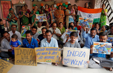 Fans offer a special prayer for the victory of the Indian cricket team in the ICC Cricket World Cup semi-final against New Zealand, inside a temple in Ahmedabad