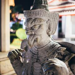 Statue, sculpture at Wat Arun Temple. Bangkok, Thailand.