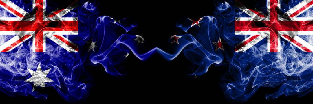 Australia vs New Zealand, New Zealander smoky mystic flags placed side by side. Thick colored silky smokes combination of national flags of Australia and New Zealand, New Zealander