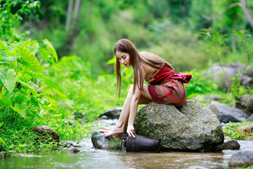 Asian sexy woman washing in streams The girl was bathing in the brook, woman washing in the stream, country girl portrait in outdoors.