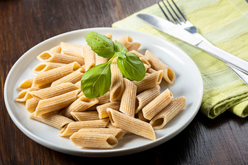 Fototapete - pasta, wholemeal penne with basil