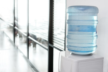 blue water gallon on electric water cooler