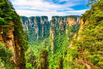 Zhangjiajie National Forest Park. Gigantic quartz pillar mountains rising from the canyon during summer sunny day. Hunan, China. Fototapete