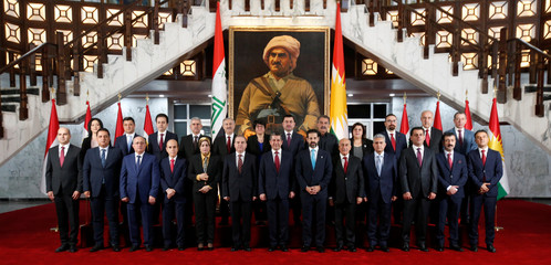 Members of the new cabinet of the Kurdistan parliament headed by Prime Minister Masrour Barzani pose for a family photo, in Erbil