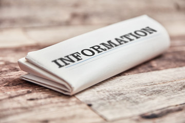 Information newspaper folded on table Wall mural