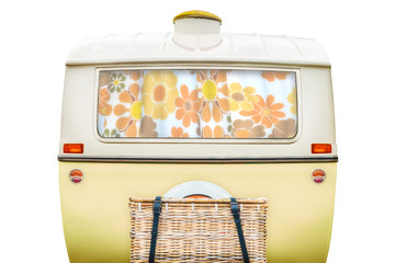 Vintage rear of a caravan in two tone yellow and white isolated on white