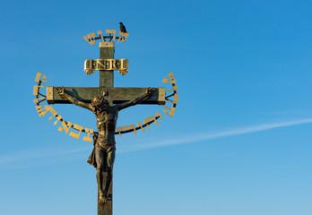 Metal crucifix decorated with golden hebrew words