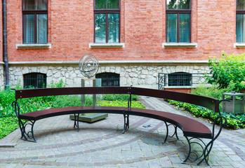 KRAKOW, POLAND - JULY 15, 2016: Modern bench in Professors's garden of The Jagiellonian University