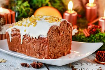 Christmas gingerbread cake among traditional decorations.