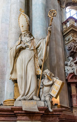 Pope statue sculpted on marble with golden ornaments