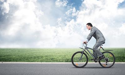 Businessman hurry to work by bike