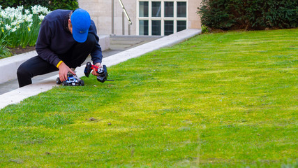 Keuken foto achterwand Lime groen Man playing with remote controlled car in a green lawn