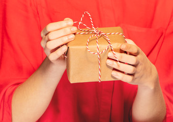 woman's hands untying lace bow on Christmas gift