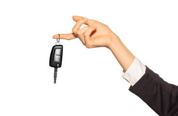 Female hand with alarm key fob hanging on finger