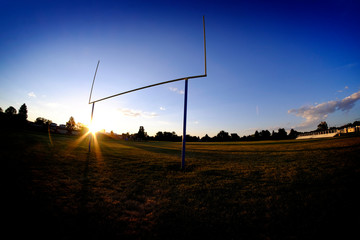 Football Goalposts Goal Posts at Sunset Sky and Bleachers