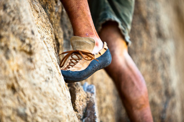 A man's climbing shoe in low depth of field at Granite Point in Eastern Washington.