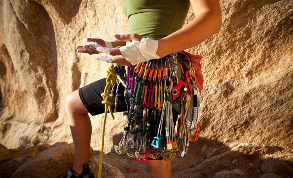 A woman gets geared up for a trad climb at Joshua Tree National Park.