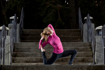 Noelle Zmuda doing a low lunge backbend, or anjayenasana, pose during a cold outdoor yoga session in Moscow, Idaho.