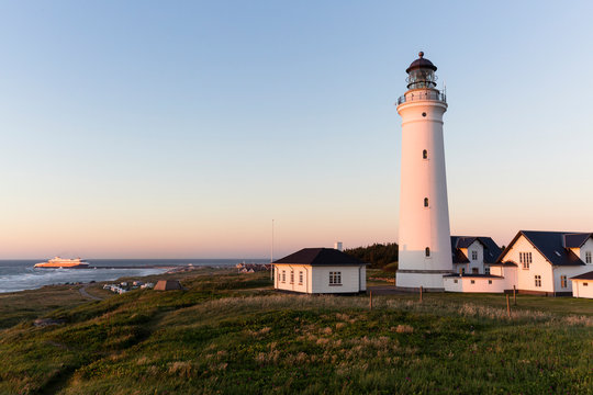 """Hirtshals, Nordjylland, Denmark: The lighthouse with the campsite and a """"ColorLine"""" ferry from Norway entering the harbour in the background."""