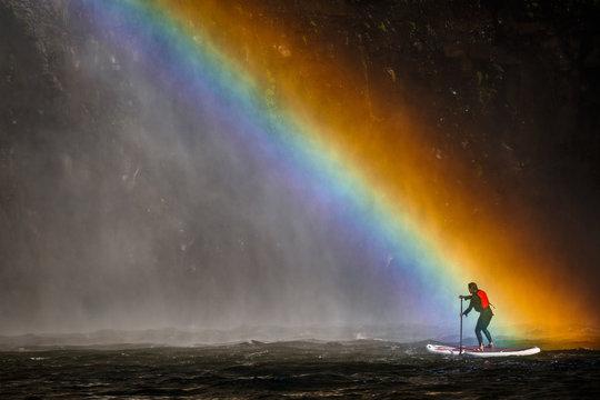 Woman paddleboarding by Palouse Falls