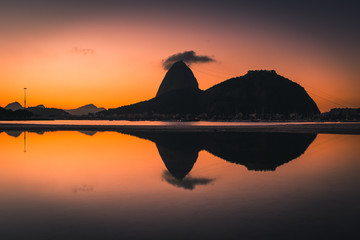 Wall Mural - View of the Sugarloaf Mountain Reflected on Water by Sunrise, in Rio de Janeiro, Brazil