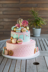 Colorful homemade macarons cake on pyramid in many levels