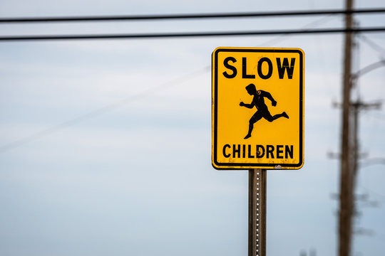 slow children caution sign on a street