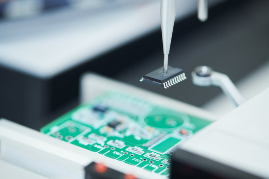 microchip semiconductor manufacturing. automatic machine robot installing chip on board.