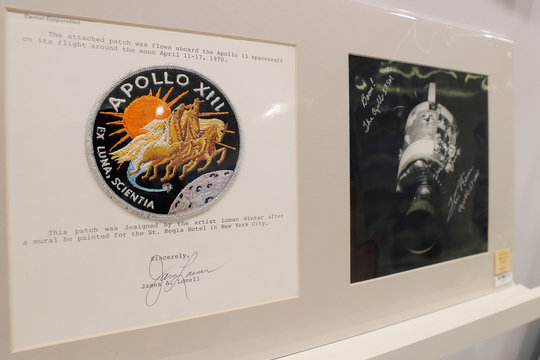"""A mission patch and signed photograph from Apollo 13 is displayed as part of Christie's upcoming """"One Giant Leap: Celebrating Space Exploration 50 Years After Apollo 11"""" auction in New York"""