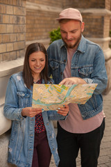 two hipsters looking at a city map.