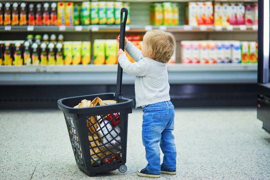 Adorable baby girl in supermarket