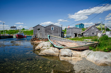 Peggys Cove, Nova Scotia - A beautiful tranquil summer day at Peggys Cove, Nova Scotia, Canada. The rugged beauty of Peggys Cove is one of Nova Scotia's major tourist attractions.