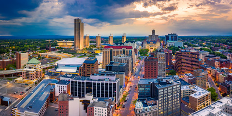 Aerial panorama of Albany, New York downtown along State street, at dusk. Albany is the capital...
