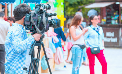 Broadcasting and Recording with Digital Camera - Cameraman Shooting Film Scene With Camera