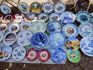 porcelain plates with beautiful pictures at the flea market