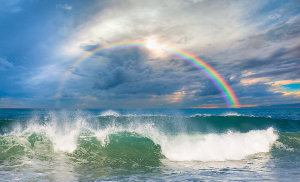 Rainbow over the stormy sea after rain