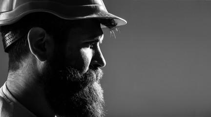 Portrait architect builder, civil engineer working. Builder in hard hat, foreman or repairman in the helmet. Bearded man worker with beard in building helmet or hard hat. Man builders, industry. Wall mural