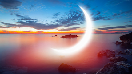 Wall Mural - Night sky with crescent moon in the clouds