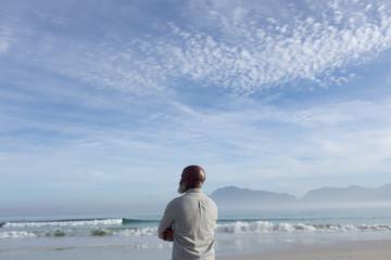 Man gazing at the beach.