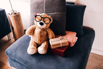 teddy bear with Christmas presents