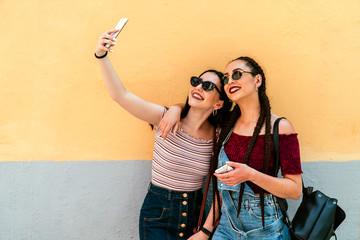 Beautiful woman friends taking a selfie