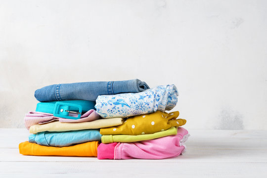 Stack of folded, colorful clean casual clothes.