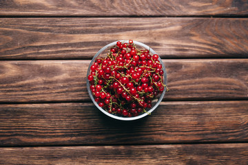 Fresh red currant on a plate.