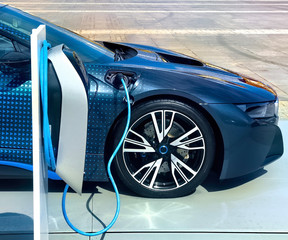Electric vehicle being plugged in