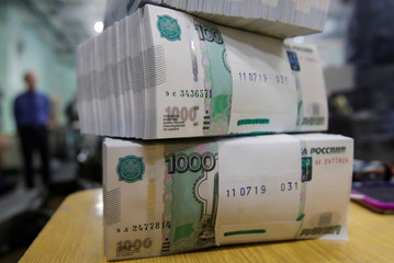 Packs of 1000 Russian Roubles notes are pictured at Goznak printing factory in Moscow