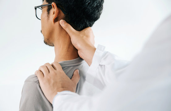 Physiotherapist doing healing treatment on man's neck,Chiropractic adjustment, pain relief concept.office syndrome