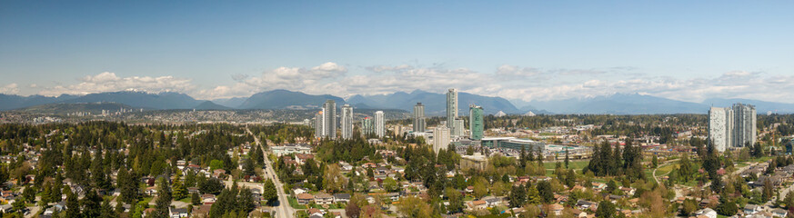 Panoramic view of residential neighborhood in the city during a sunny day. Taken in Greater Vancouver, British Columbia, Canada.