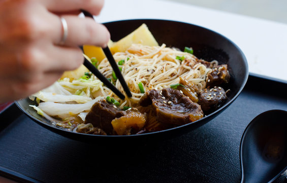 Closeup of a bowl of beef and vegetable stir fry.