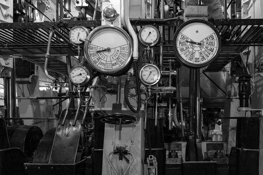 The engine room of an old steamer. Steam pressure sensors, steam boiler pipes.