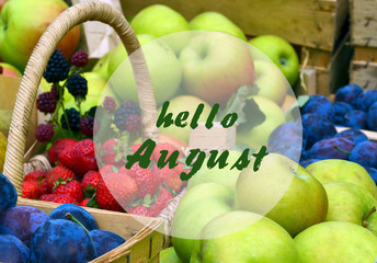 Hello August greeting on a ripe garden  fruits blurred background.Summer harvest concept.Selective focus.